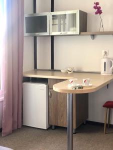 Кухня или мини-кухня в Сеть отелей ЖАРА