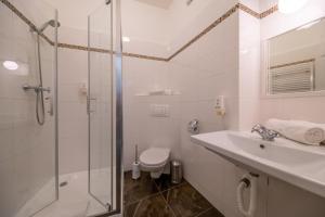 A bathroom at Cathedral Prague Apartments