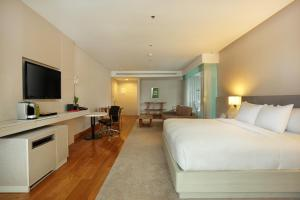 A television and/or entertainment center at The Stones - Legian Bali, Marriott's Autograph Collection Hotel