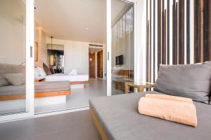 A bed or beds in a room at G Hua Hin Resort & Mall
