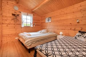 A bed or beds in a room at Sireksstadir Farm Holiday