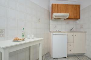 A kitchen or kitchenette at Soula Hotel