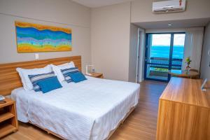 A bed or beds in a room at Grande Hotel da Barra