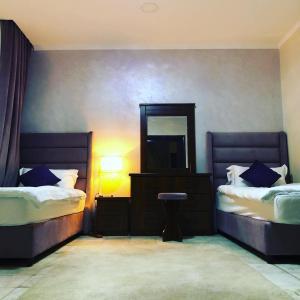 Cama ou camas em um quarto em Burj Al Masaraat Corniche Jeddah