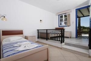 A bed or beds in a room at Stella Naxos Island