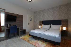 Кровать или кровати в номере Hotel Spatz