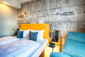 A bed or beds in a room at LOGINN Hotel Leipzig by ACHAT