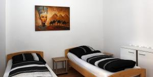 A bed or beds in a room at Ferienwohnung MKopp 4
