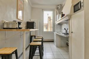 A kitchen or kitchenette at NOCNOC - L'Olympe