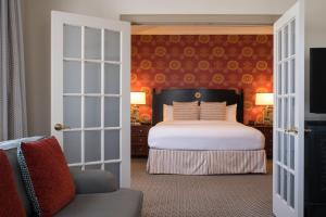 A bed or beds in a room at The Stephen F Austin Royal Sonesta Hotel