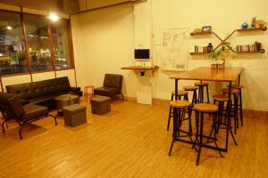 The lounge or bar area at Petite Hostel