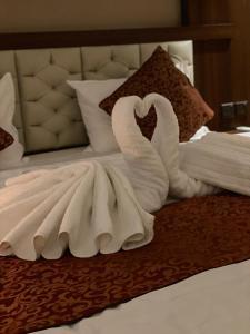 Cama ou camas em um quarto em Restin Hotel