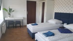 Łóżko lub łóżka w pokoju w obiekcie Willa Aster