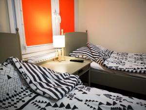 Łóżko lub łóżka w pokoju w obiekcie Ośrodek Wypoczynkowo-Rehabilitacyjny TPD