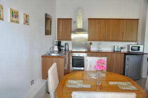 A kitchen or kitchenette at Marigot Palms Luxury Caribbean Apartment Suites