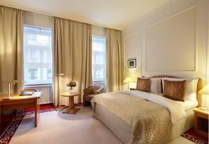 Кровать или кровати в номере Отель Балчуг Кемпински Москва