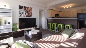 A television and/or entertainment center at Chic High-rise with Great DT Views