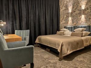 Łóżko lub łóżka w pokoju w obiekcie Hotel Szara Willa