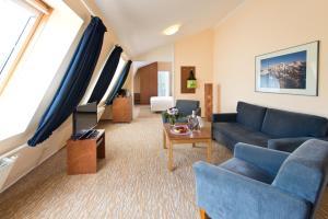 A seating area at ACHAT Hotel Buchholz Hamburg