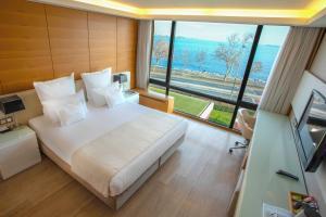 سرير أو أسرّة في غرفة في فندق كاليون إسطنبول
