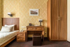 Кровать или кровати в номере Kravt Sadovaya Hotel