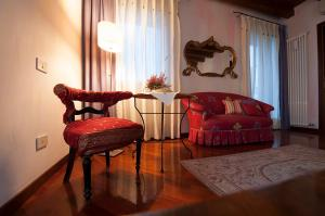 A seating area at B&B Portico Rosso