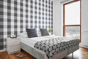 Łóżko lub łóżka w pokoju w obiekcie IRS ROYAL APARTMENTS Apartamenty IRS Nadmorski Dwór