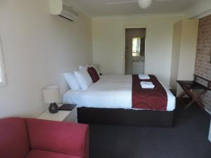 A bed or beds in a room at Sussex Shores
