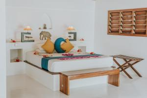A bed or beds in a room at Navutu Stars Resort