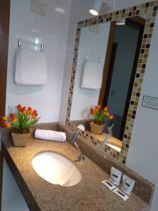 A bathroom at Executive Hotel