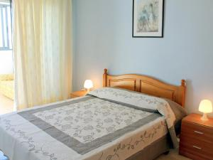 A bed or beds in a room at Apartment Kenedy II