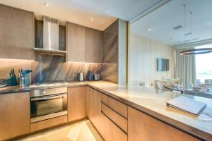 A kitchen or kitchenette at Maison Privee - FIVE Palm Residences