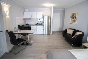 A kitchen or kitchenette at ARABEST Aparthotel & Boardinghouse