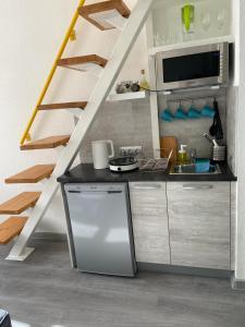 Кухня или мини-кухня в Апартаменты Ожешко 34