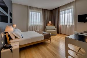 A bed or beds in a room at Best Western Plus Hotel Bologna
