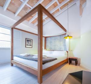 A bed or beds in a room at Brondo Architect Hotel