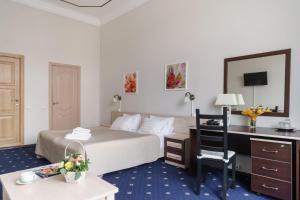 Cama o camas de una habitación en Aleksandr Hotel