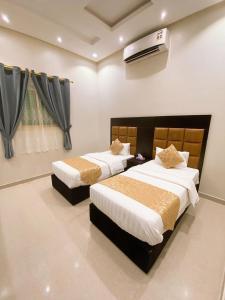 Cama ou camas em um quarto em منازل الذهبيه 2