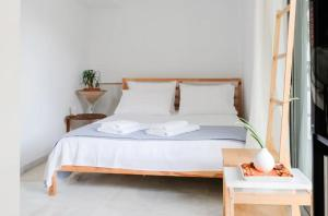A bed or beds in a room at Bright Eco Studios