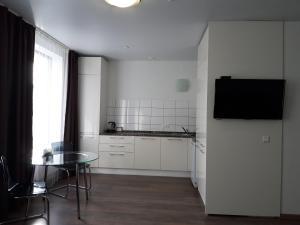 Кухня или мини-кухня в Radius Central House апартаменты