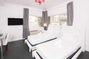 A bed or beds in a room at The Donovan at Miami Beach