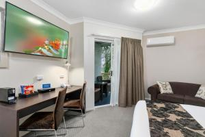 A television and/or entertainment center at Best Western Kimba Lodge