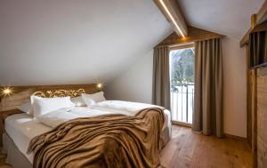 A bed or beds in a room at Hotel Leitenhof SUPERIOR