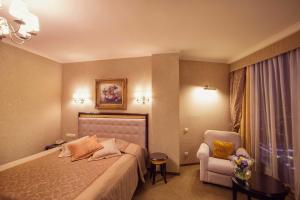 A bed or beds in a room at Vysotsky Hotel