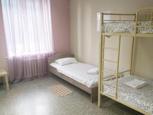 Кровать или кровати в номере Hostel Brigit na Ladojskoy