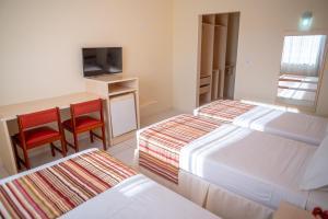 Cama ou camas em um quarto em Portobello Park Hotel