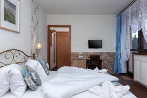 Posteľ alebo postele v izbe v ubytovaní Goralturist
