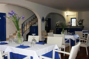 A restaurant or other place to eat at Hotel Ristorante Meson Feliz