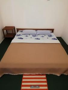 A bed or beds in a room at Tabun Homestay
