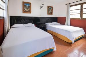 A bed or beds in a room at OYO Cabañas Suytun